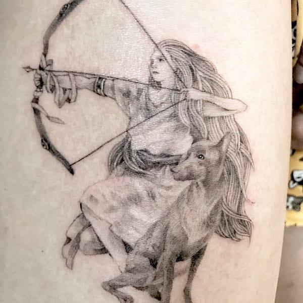 A realistic archer tattoo by @anneauxtattoo - Creative Sagittarius zodiac tattoo ideas
