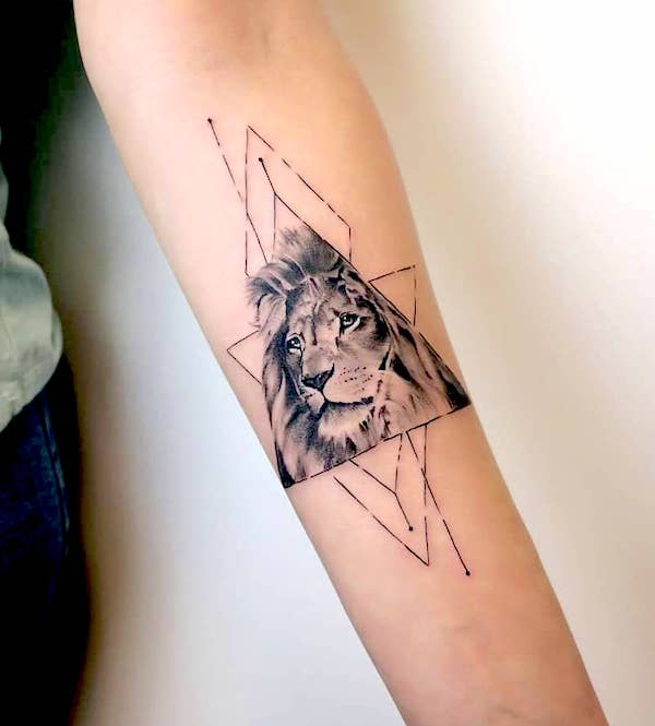 A geometric lion tattoo by @tat2society - Bold statement Leo tattoos for men - OurMindfulLife.com