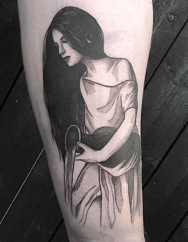 A blackwork realism tattoo by @freaky.ink