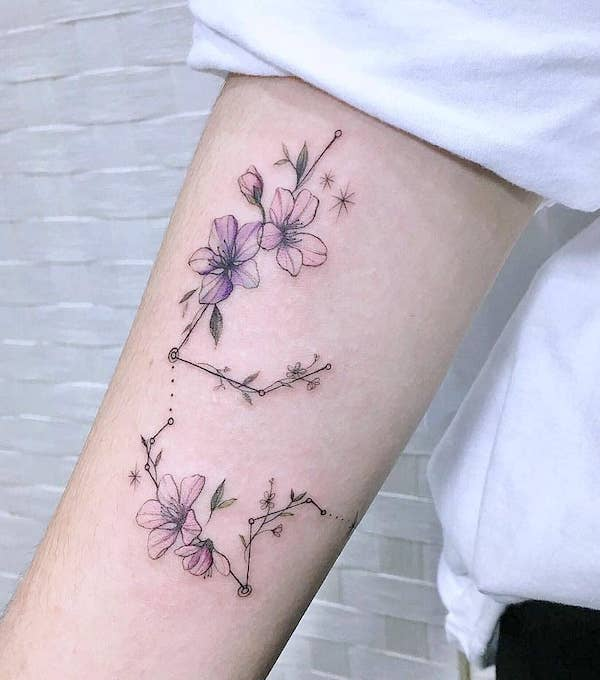 A floral Aquarius constellation tattoo by @tattoosphera