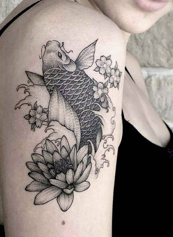 An intricate fish and water lily sleeve tattoo - Pisces symbol and constellation tattoos