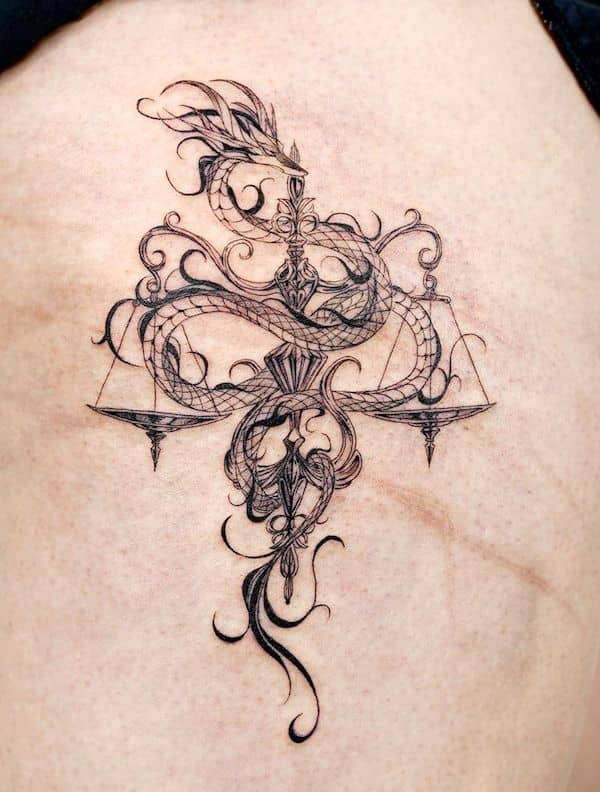 An intricate dragon tattoo for Libra men by @bium_tattoo - Bold Libra tattoo ideas for men