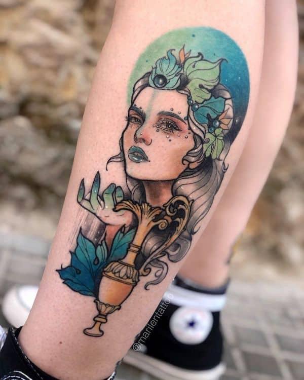 A realistic leg portrait tattoo by @marilentattoo
